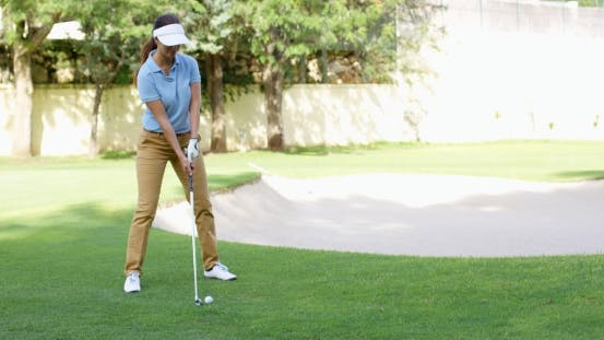 Thumbnail for Woman Golfer About To Play a Stroke On The Green