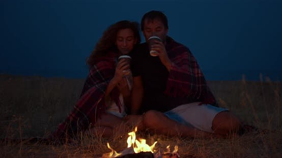 Thumbnail for Romantic Couple Sitting Around a Campfire at Night.