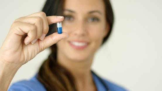 Thumbnail for Doctor Or Nurse Holding Up a Capsule
