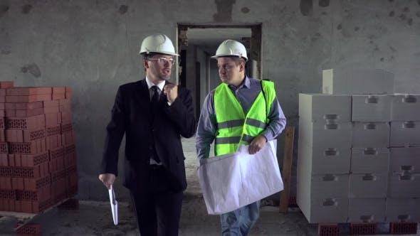 Architect Talking To Foreman