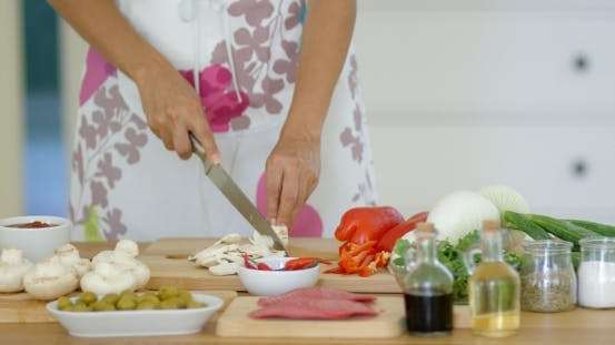 Thumbnail for Housewife Preparing Dinner Slicing Fresh Mushrooms
