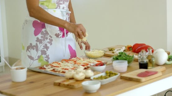 Thumbnail for Woman Preparing a Homemade Pizza In The Kitchen