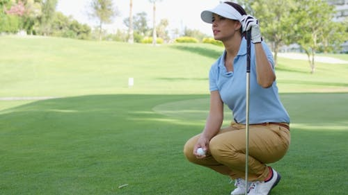 Woman Wearing White Visor And Blue Polo Shirt