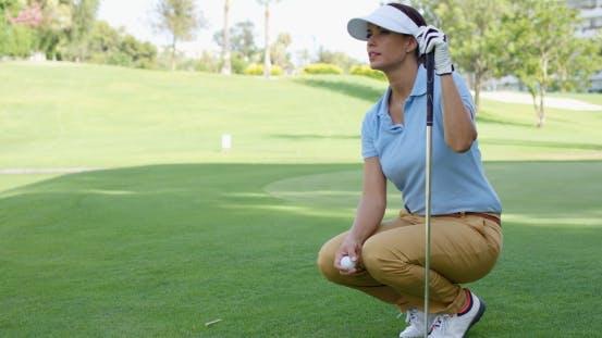 Thumbnail for Woman Wearing White Visor And Blue Polo Shirt