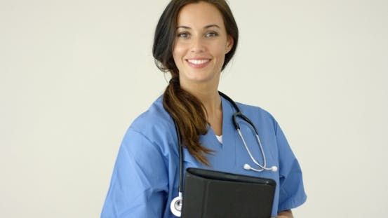 Thumbnail for Smiling Young Female Physician Smiles At Camera