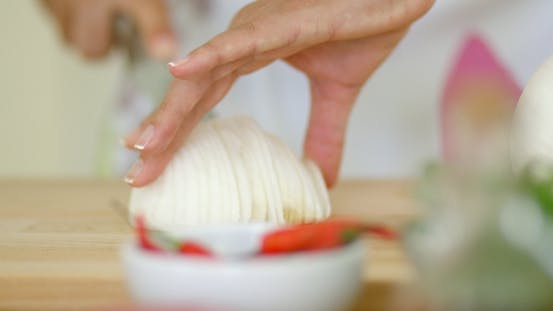 Thumbnail for On Hands Cutting Fresh Onion
