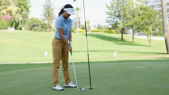 Thumbnail for Woman Golfer About To Sink Her Putt