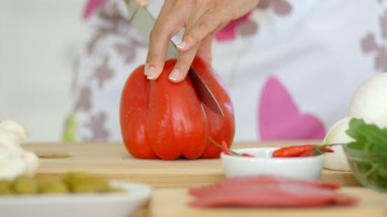 Thumbnail for Housewife Chopping a Fresh Red Bell Pepper