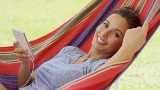 Thumbnail for Happy Young Woman Listening To Music In a Hammock