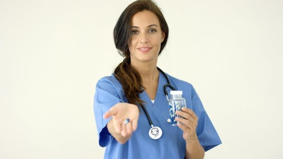 Thumbnail for Attractive Female Doctor Holding Out a Pill