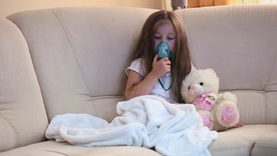 Little Girl Making Inhalation
