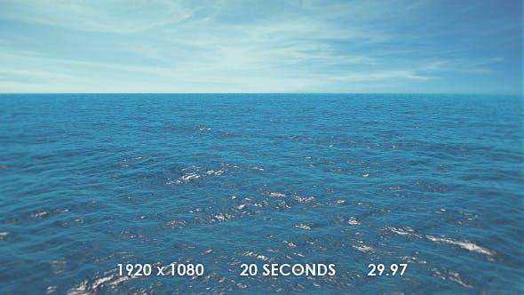 Flying Above the Ocean Towards Sea Horizon