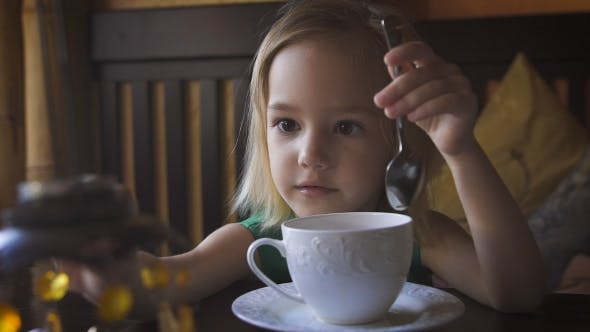 Thumbnail for A Little Kid Having Breakfast At a Cozy Cafe