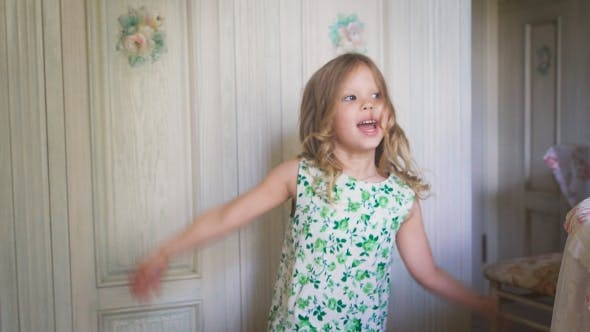Thumbnail for A Happy Little Girl Is Jumping In The Bright Room.