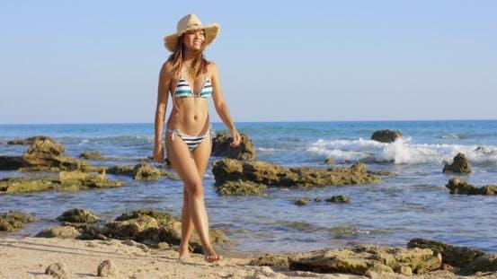 Thumbnail for Attractive Woman In a Bikini Walking On a Beach