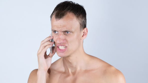 Cover Image for Angry Man Talking on Smartphone