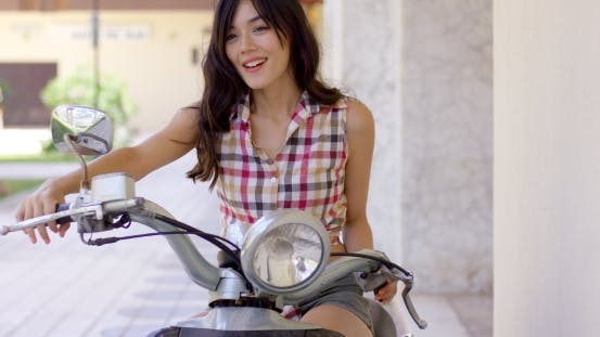 Thumbnail for Attractive Young Woman On a Motorbike