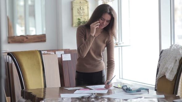 Thumbnail for Woman Sketches And Talking On The Phone.