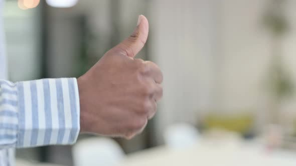 Close Up of African Man Showing Thumbs Up Gesture