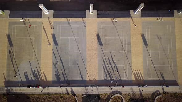 Thumbnail for Aerial view of four basketball courts in an urban setting.