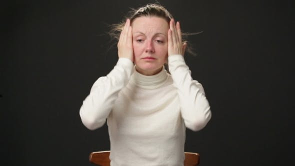 Cover Image for Woman Feeling Headache