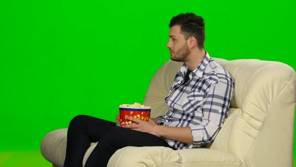 Thumbnail for Man Watching TV And Smiling. Green Screen