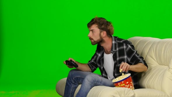 Thumbnail for Man Is Freaking Out And Spilled Popcorn On The Couch. Green Screen