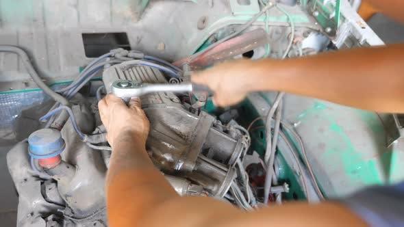 Professional Mechanic Fixing Motor on Old Car Using Tool
