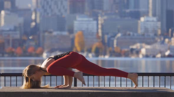 Thumbnail for Split Leg Arm Balance Pose Woman Doing Yoga City Metropolis Background