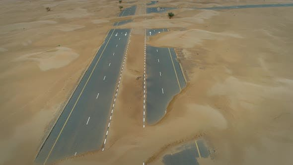 Thumbnail for Aerial abstract view of road covered by sand in the desert, Abu Dhabi, UAE.