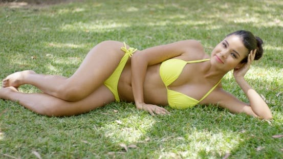Thumbnail for Beautiful Young Woman In Bathing Suit On Lawn