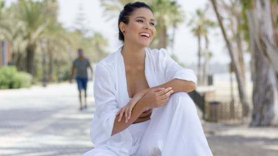 Thumbnail for Cheerful Woman In White Robe Laughing Outdoors