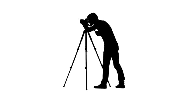 Thumbnail for Operator Sets The Camera To a Tripod. Silhouette. White