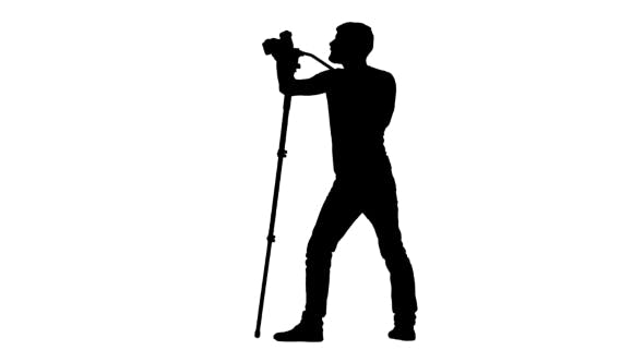 Thumbnail for Operator Makes Shooting, Picking Up The Desired Angle. Silhouette. White