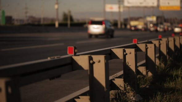 Thumbnail for Movement Of Cars On Highway In Sunny Day. Roadside In Area Of Focus.