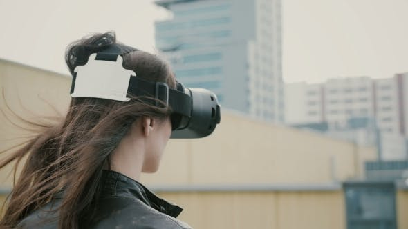 Thumbnail for Brunette Girl Uses 3D Virtual Reality Headset on the Roof