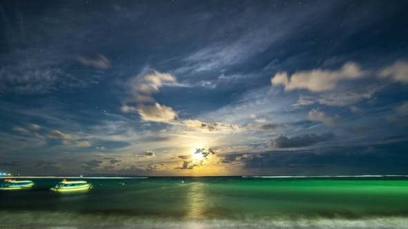 Cover Image for Moonrise Breaks Through The Clouds Over The Sea