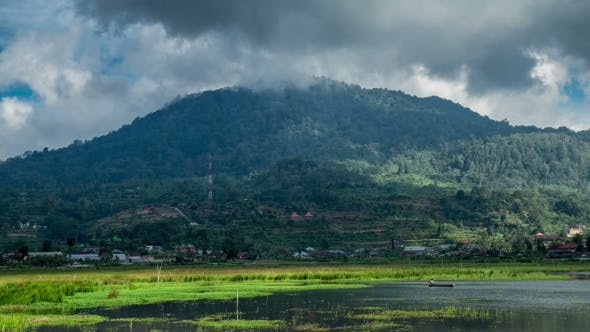 Cover Image for Clouds Over The Mountains In Near Buyan Lake.   - Bali, Indonesia, June 2016.