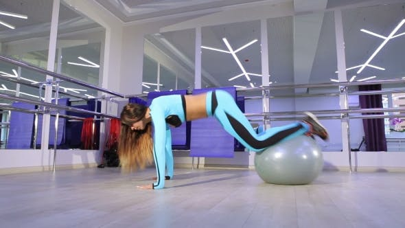 Thumbnail for Woman Doing Exercise In The Gym.