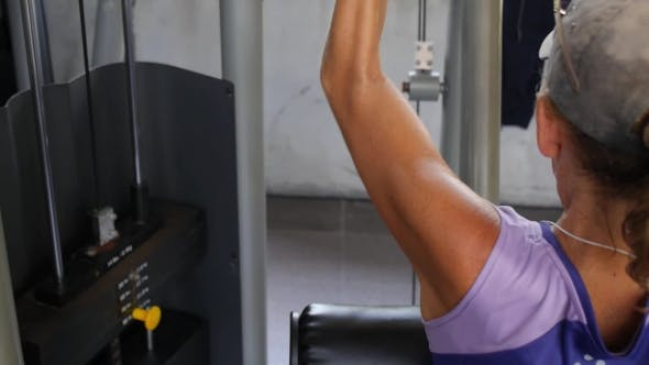 Thumbnail for Woman Workout, Building Muscles On Fitness Machine In Gym