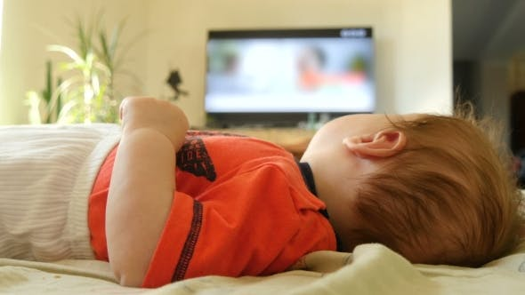 Thumbnail for Baby Boy Watching TV At Home
