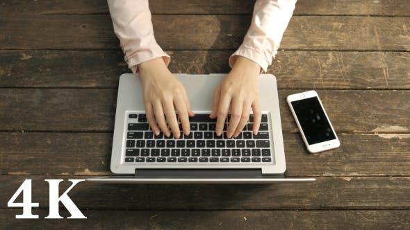 Thumbnail for Typing Laptop