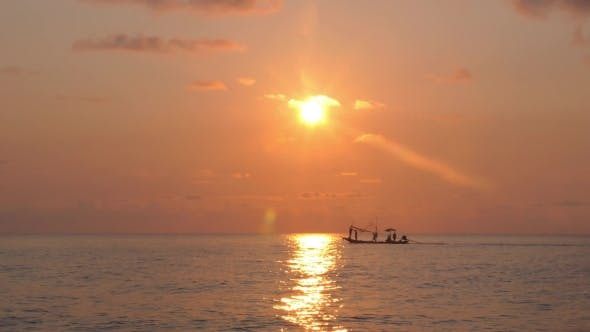 Thumbnail for Fishing Boat With Fisherman Sailing At Sunset In Sea.