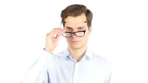 Businessman with Weak Eyesight  Wearing Glasses