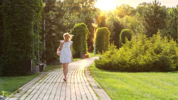 Thumbnail for Beautiful Girl Walking Alone in the Park at Sunset