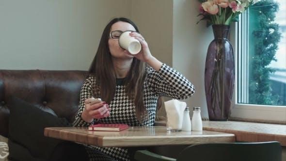 Thumbnail for Beautiful Girl Enjoying An Hot Coffee In Cafe With Window