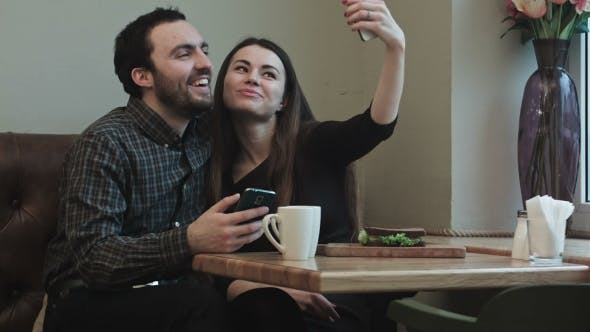 Thumbnail for Two Young People Makeing Selfy While In Cafe