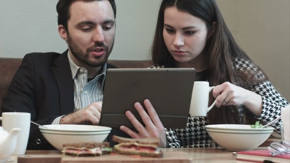 Thumbnail for Business Couple At Cafe Use Tablet