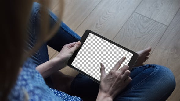 Cover Image for Beautiful Girl Using Tablet PC with Isolated Screen Sitting on the Floor at Home 1