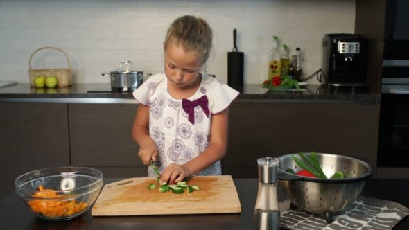 Thumbnail for Little cute Girl  Preparing salad In The Kitchen
